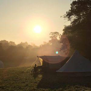 building community camp site at dusk